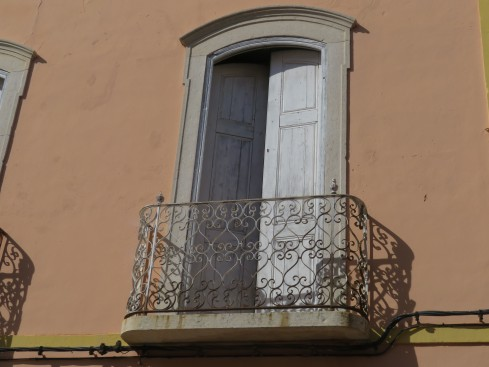 Passed this wonderful balcony on our way through the village. How I long to see beyond the doorway!