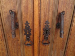 These elongated door knockers resemble dogs.