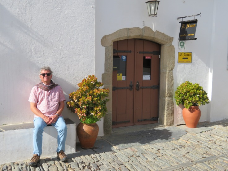 My husband enjoying the sunshine at the door of our hotel as we wait for the others to begin our exploration.