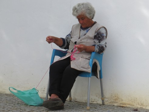 This woman was sitting in the shade at the side of the road, knitting up a storm. What stopped us, was the next photo!!