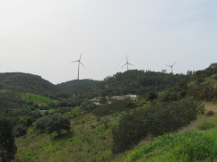 Magnificent wind turbines gently purring all along the mountain ridge.