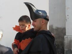Father and son in costume waiting for the parade to begin.