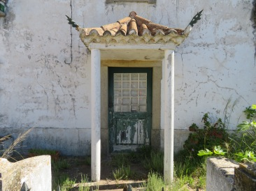 An abandoned property with a lovely old doorway.