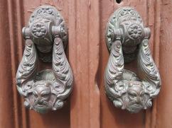 Detailed door knockers.