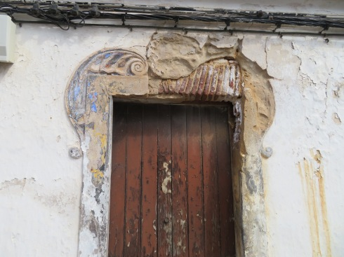 This old doorway, looking tired and in need of tender loving care, must have been quite beautiful before the paint faded and the owner moved out.