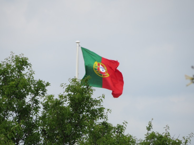 The proud Portugal flag flapping in the breeze at the entrance to the castle