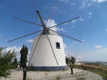 An old windmill at top of the hillside where a military fortress once stood.