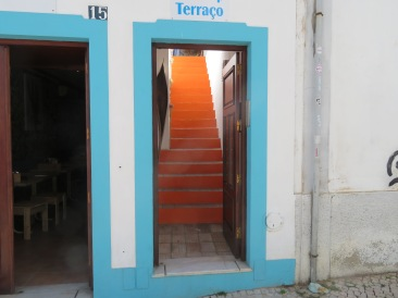 How wonderful, the orange steps against the blue door frame.