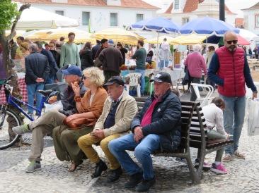 People were enjoying people watching and sampling the treats.