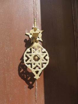 An intricate and religious doorknocker.