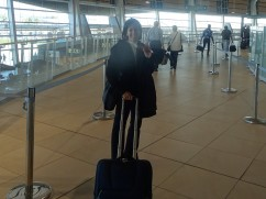 And here she is, heading through security. And no, that isn't her halo......it's the light from all the windows!