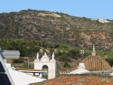 This is to the north east, the steeple of the old church and the mountain slopes behind them.