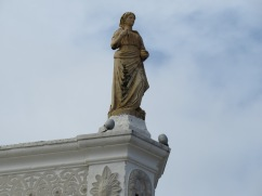 I noticed a few statues very high on buildings that I hadn't registered in the past. Some looked newer and not as interesting but this one, and the next, seemed aged and well situated.