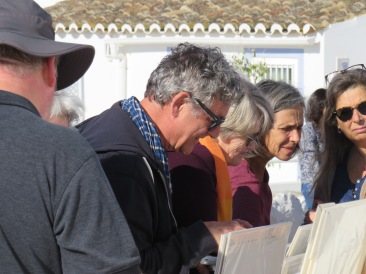 Marc checking out a fellow artist from the Algarve Artists Community, of which he is a member.