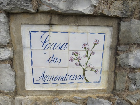 Lovely hand painted till inset in a fence near a beautiful house tucked away in an almond grove. Aptly named.