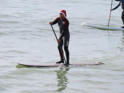 Paddle board Santa.