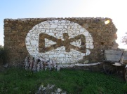 I don't know what this symbol means but it looked to have been freshly painted on the side of this old farm building.