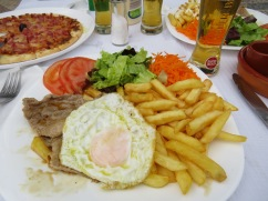 Bitoque is a traditional Portuguese dish, which consists of a lean fried or grilled steak or pork, that is usually accompanied by fries, rice, various salads and topped with an egg. This recipe has its origin in Beira's, Portugal.