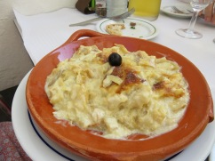 Marc and Alan both devoured their Bacalhau com natas. An oven-baked dish consisting of layers of bacalhau, onion, diced fried potato and cream, commonly spiced with nutmeg and white pepper