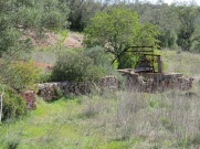 An old water well beside a very dry stream.