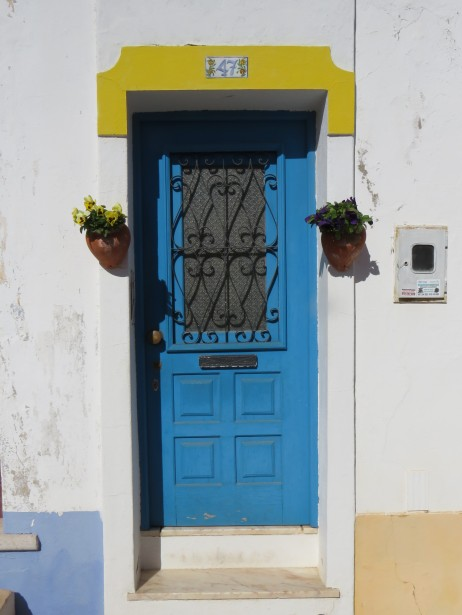 Simply a pretty doorway lovingly decorated and painted.