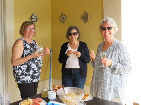 Donna, Sherry, and Patricia enjoying the food, meeting each other for the first time, and the overall ambiance of the afternoon.