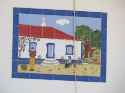 This old tilework was high on a wall way at the back of a garden. I did not take a slanted photo, it was on the wall this way. t
