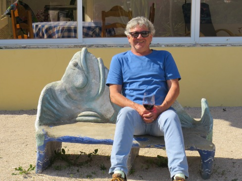 My happy husband enjoying a glass of vino, the first in quite some time, on the fish motif bench in Pat and Gary's garden.